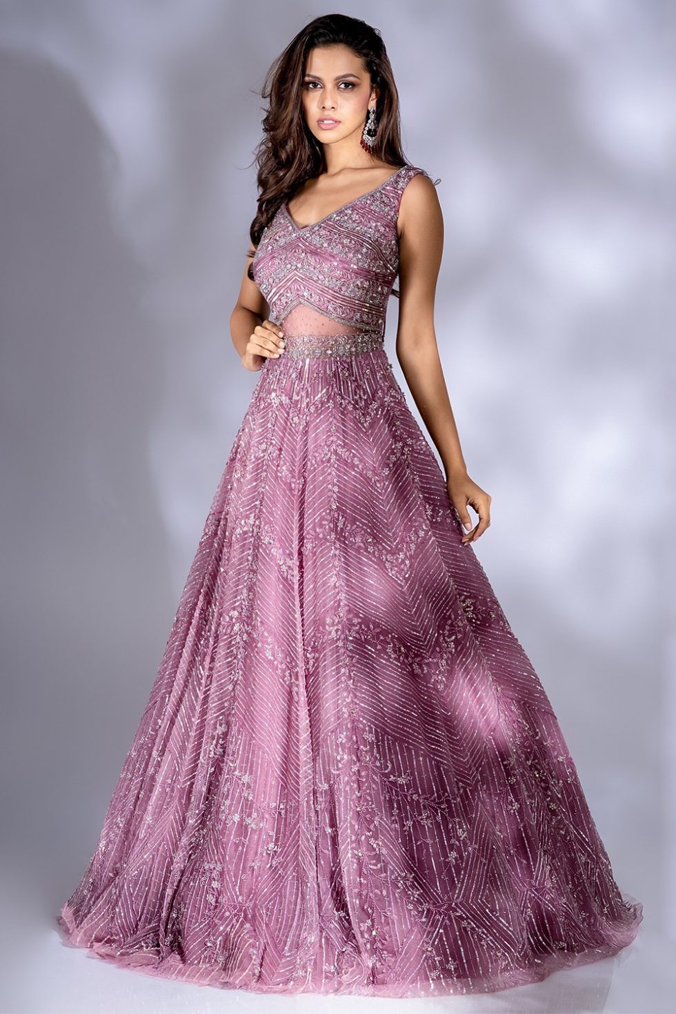 Rose purple shimmery tulle gown with self coloured and silver hand embroidery and a cut out detail.