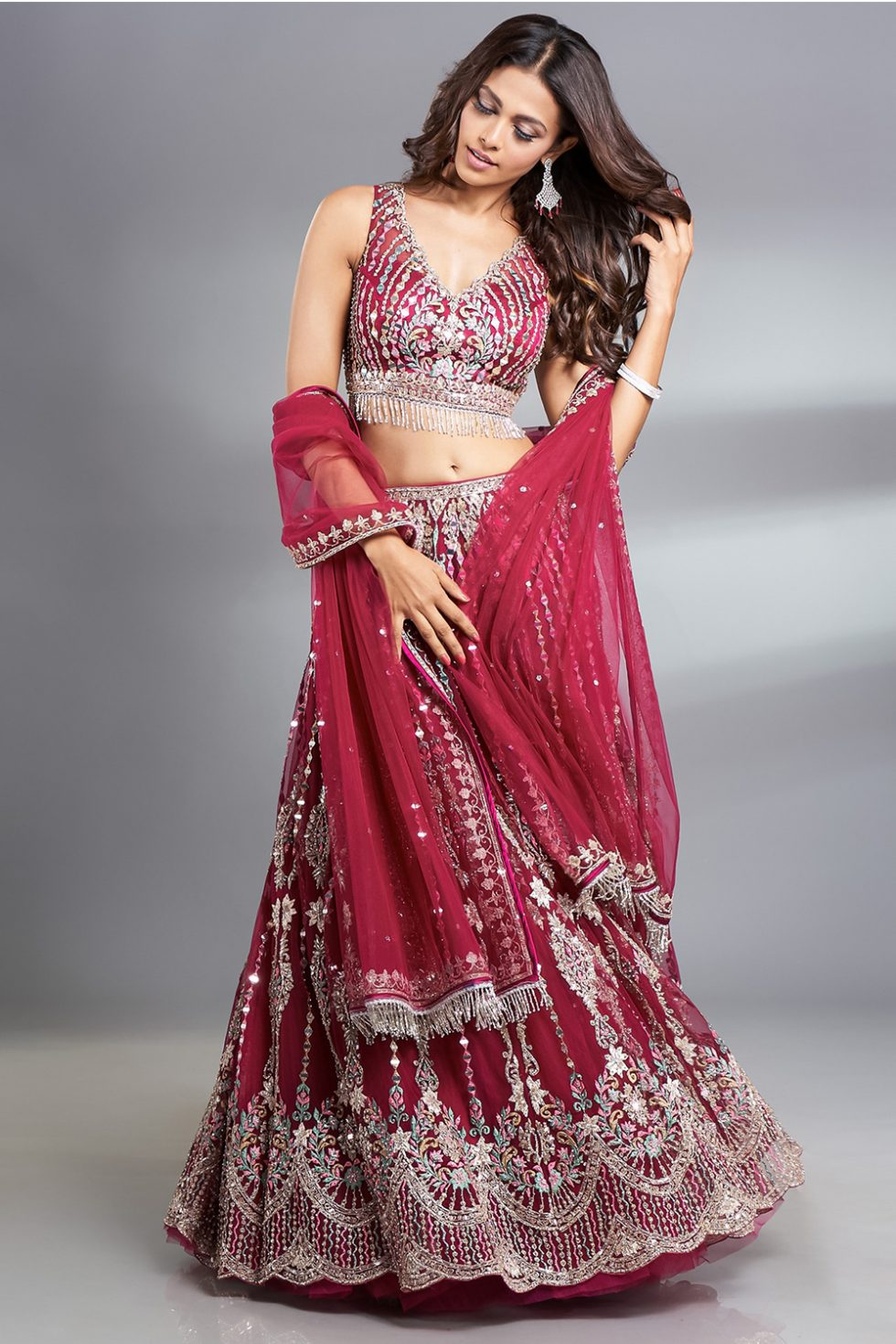 """Wine magenta lehenga set with multi coloured threadwork and """"abla"""" embroidery paired with a scalloped neckline classic blouse and a matching dupatta with tassels and silver embellishments."""