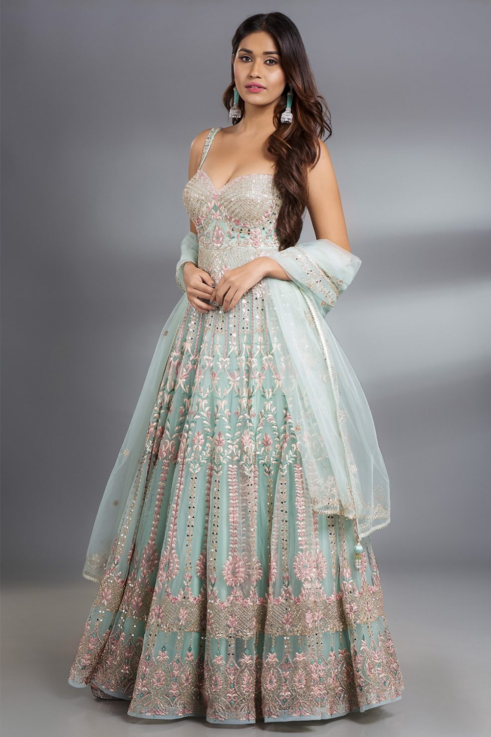 """Pastel green Anarkali Gown set with multicoloured thread work, """"abla"""" and silver highlights paired with a matching dupatta."""