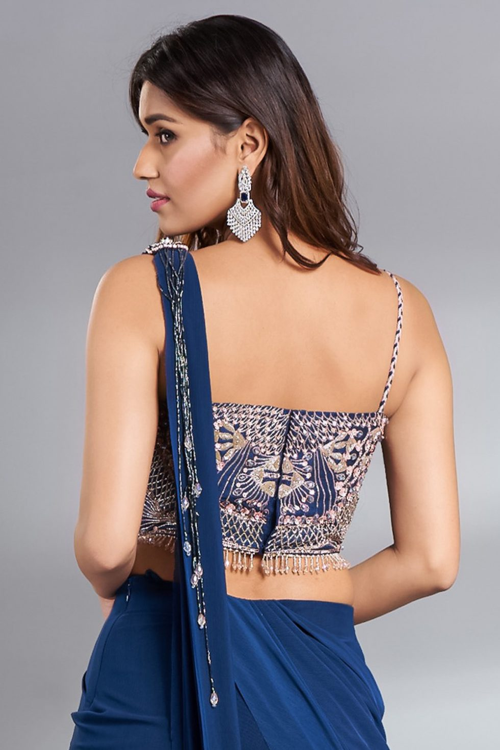 Deep blue cut out blouse with multi coloured contrast hand embroidery, tassels and braided straps