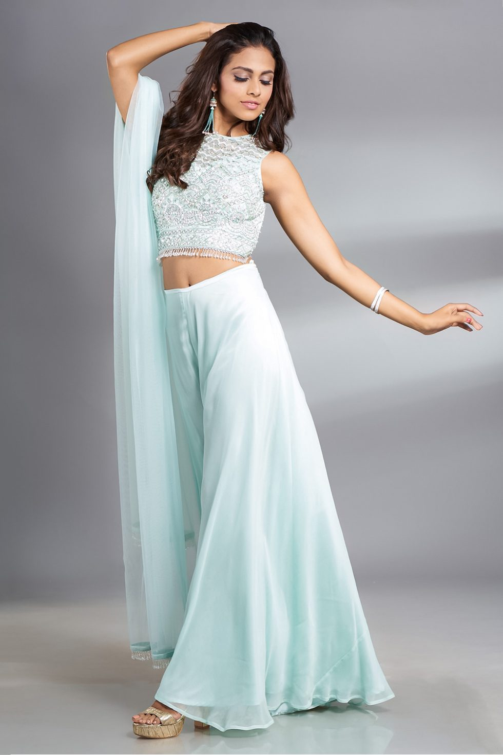 Powder blue palazzo pant set with a hand embroidered blouse and matching dupatta with tassels.