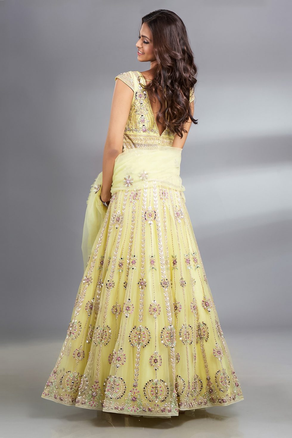 """Sunshine yellow Anarkali gown set with multi coloured thread work, gota and """"abla"""" work paired with a matching frill dupatta and silver highlights."""