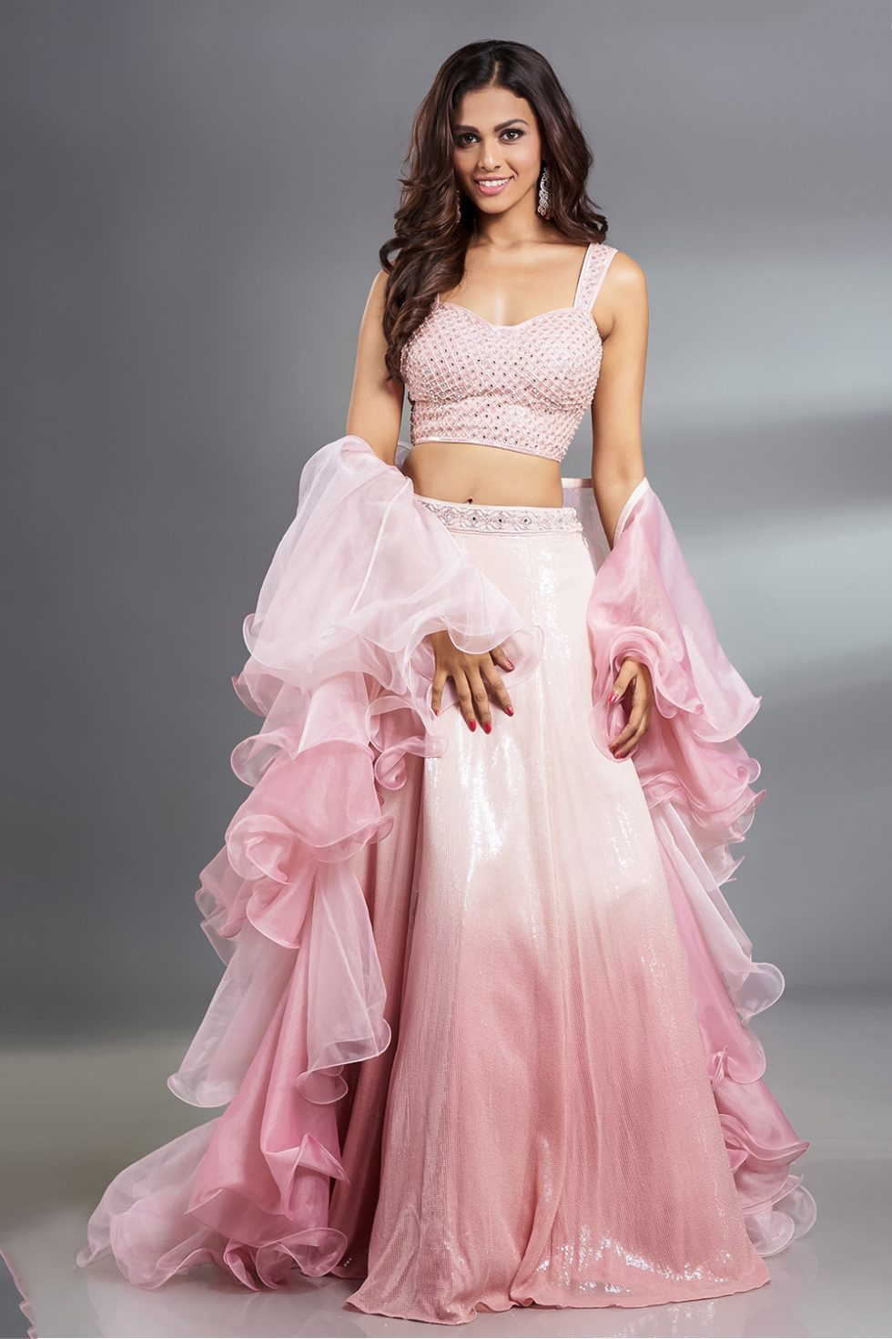 Powder pink lehenga set with a handwork blouse, paani sequin ombré skirt and ombré ruffled dupatta.