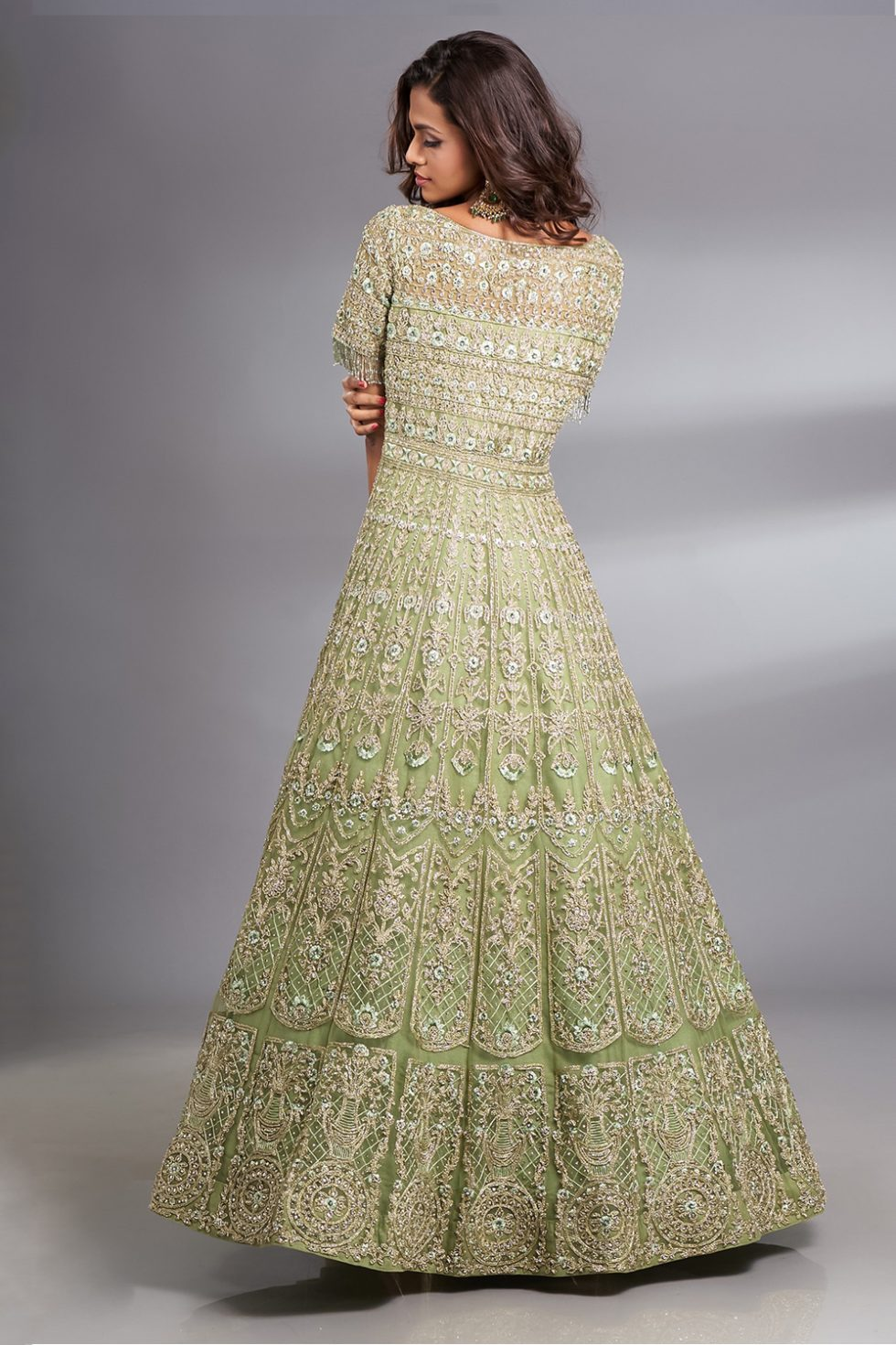 Fern green Anarkali gown set with dori thread work and silver embellishments paired with a matching dupatta and tassels.