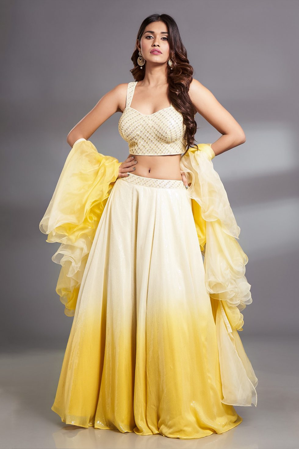 Yellow lehenga set with a handwork blouse, paani sequin pastel to sunshine yellow ombré skirt and ombré ruffled dupatta.