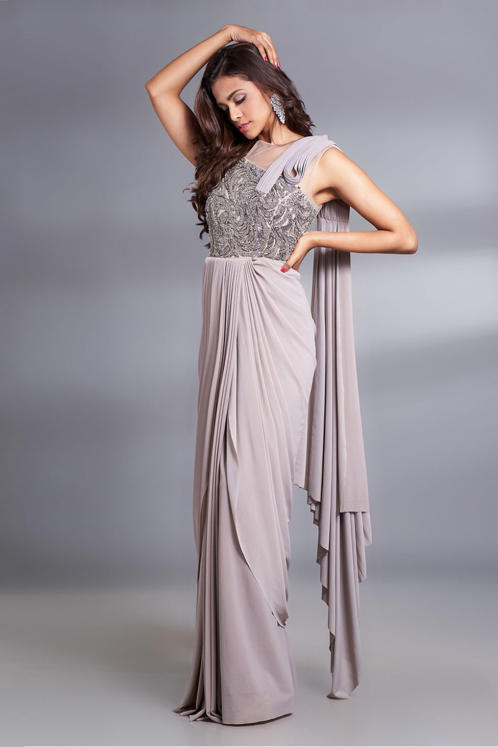 Stone grey draped saree gown with a hand embroidered metallic work bodice and a 3D detailed attached pallu.