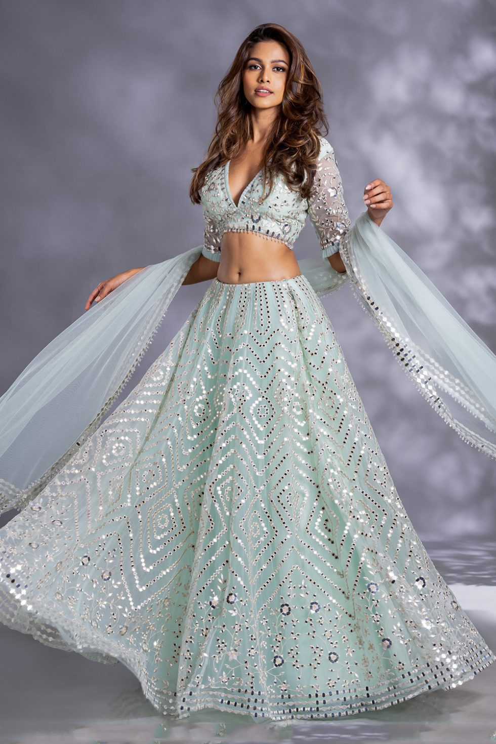 """Sea green lehenga set with """"abla"""" and ivory thread work paired with a matching blouse and dupatta with frill details"""