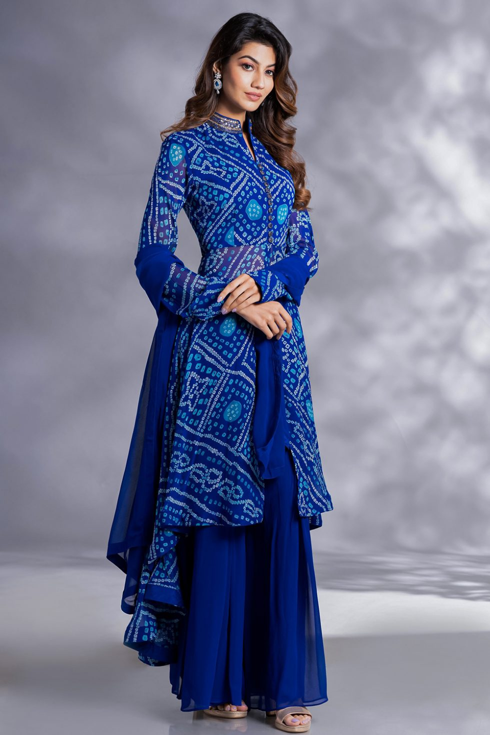 Bright blue palazzo pant set with a long bandhani kurta top with an embroidered collar paired with a matching dupatta.