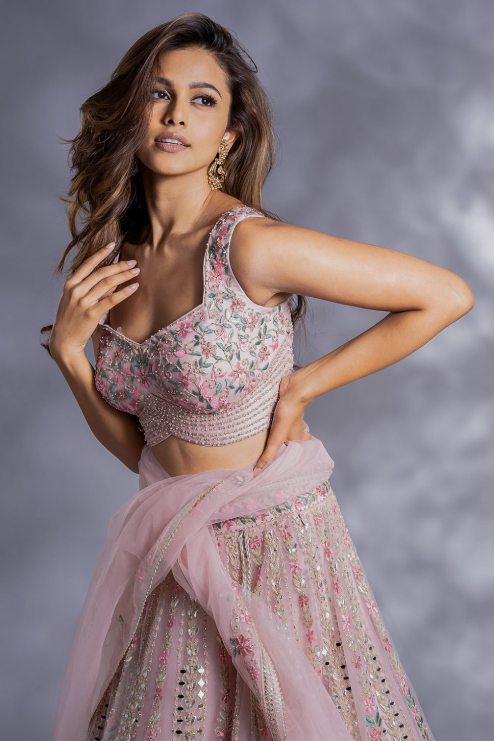 """Powder pink lehenga set with multi coloured embroidery, """"abla"""" and gota work paired with a matching dupatta and silver embellishments."""