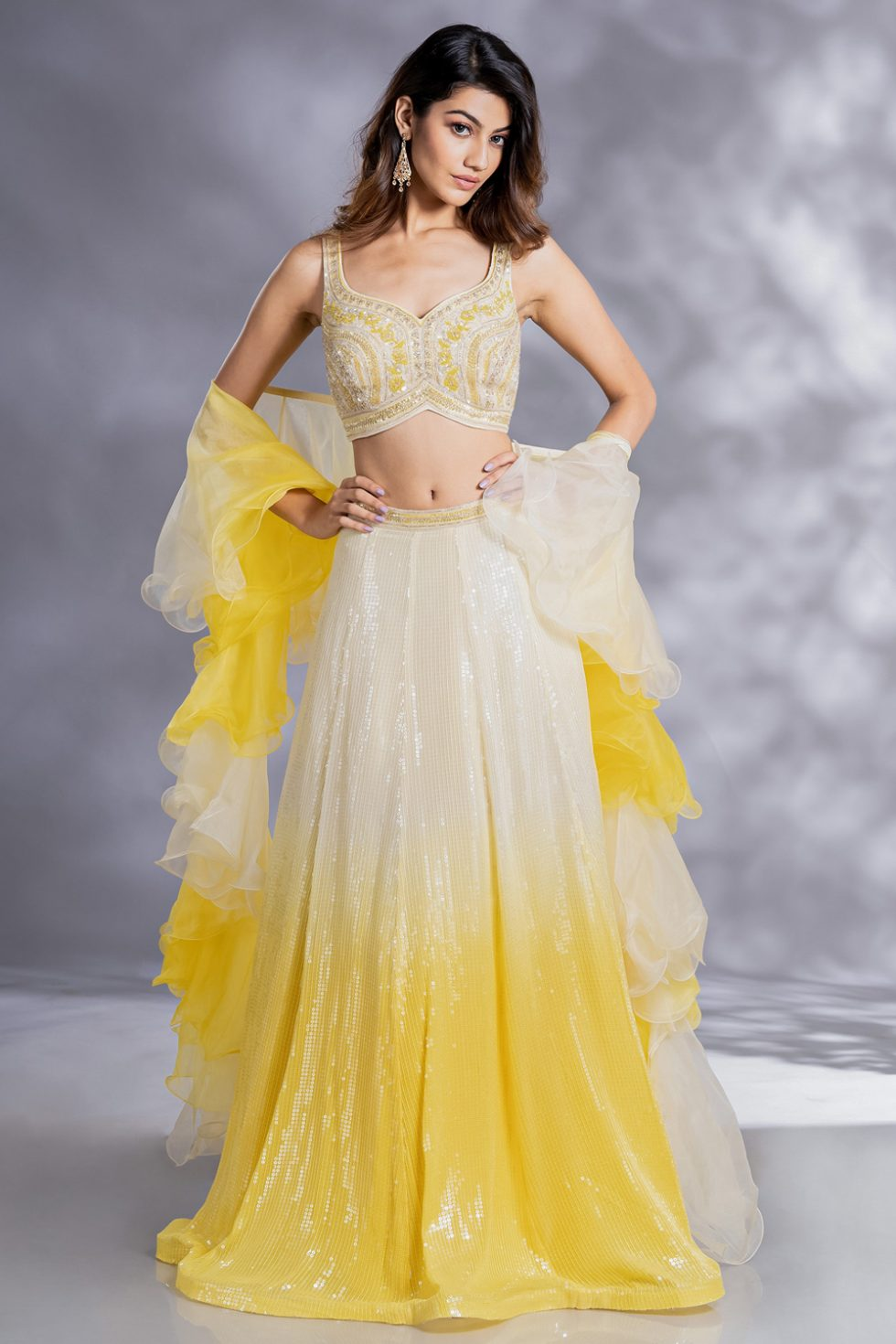 Sunshine yellow lehenga set with a handwork blouse, paani sequin pastel to sunshine yellow ombré skirt and ombré ruffled dupatta.