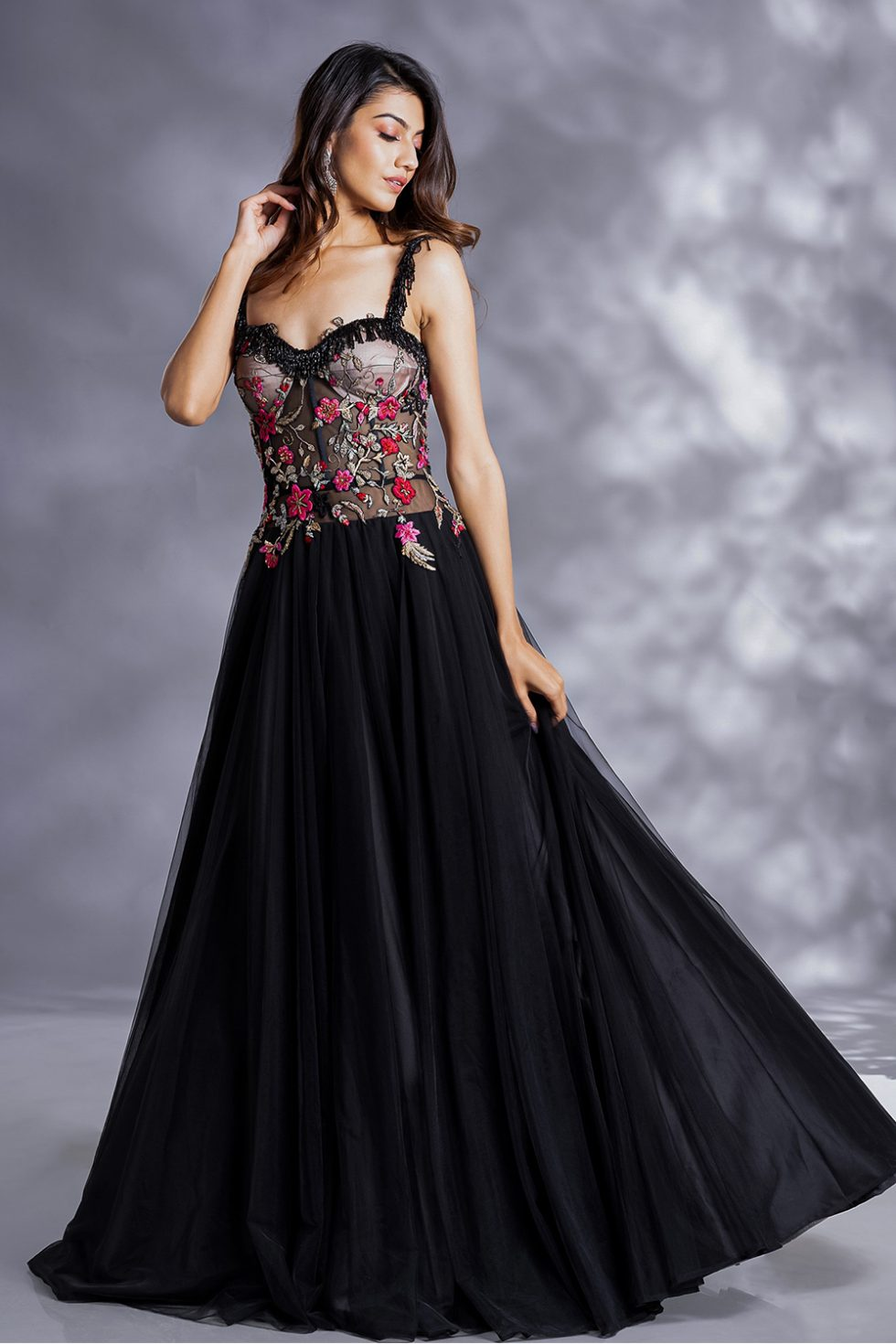 Raven black classic tulle gown with multicoloured and gold embroidery with black tassels.