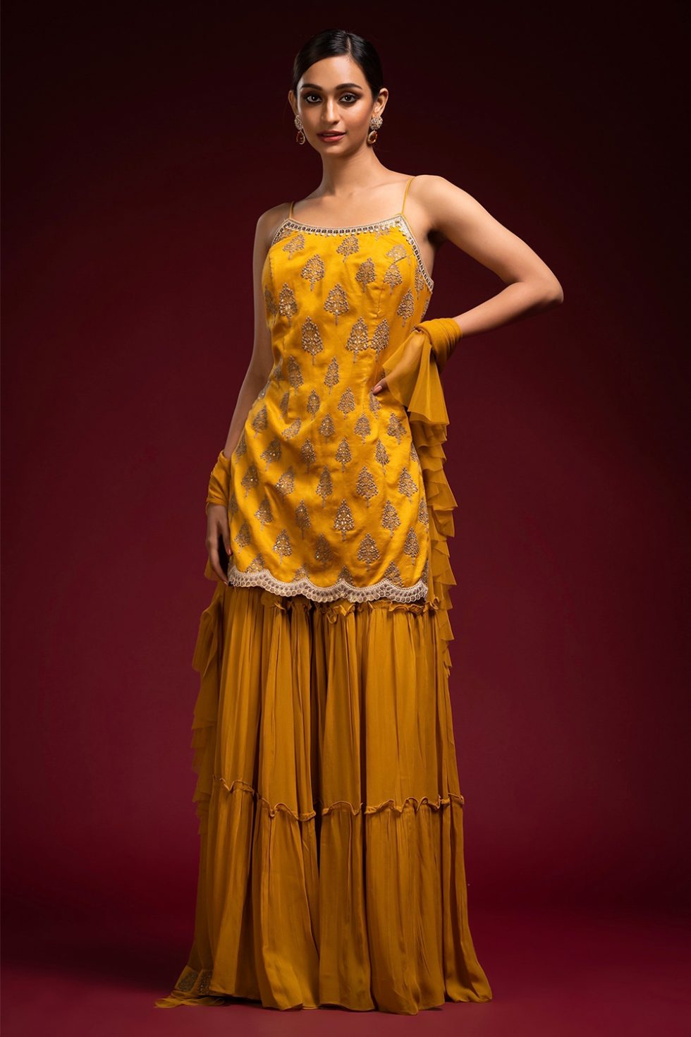 Ochre yellow tiered sharara pant set with threadwork and a frill dupatta with sequin details