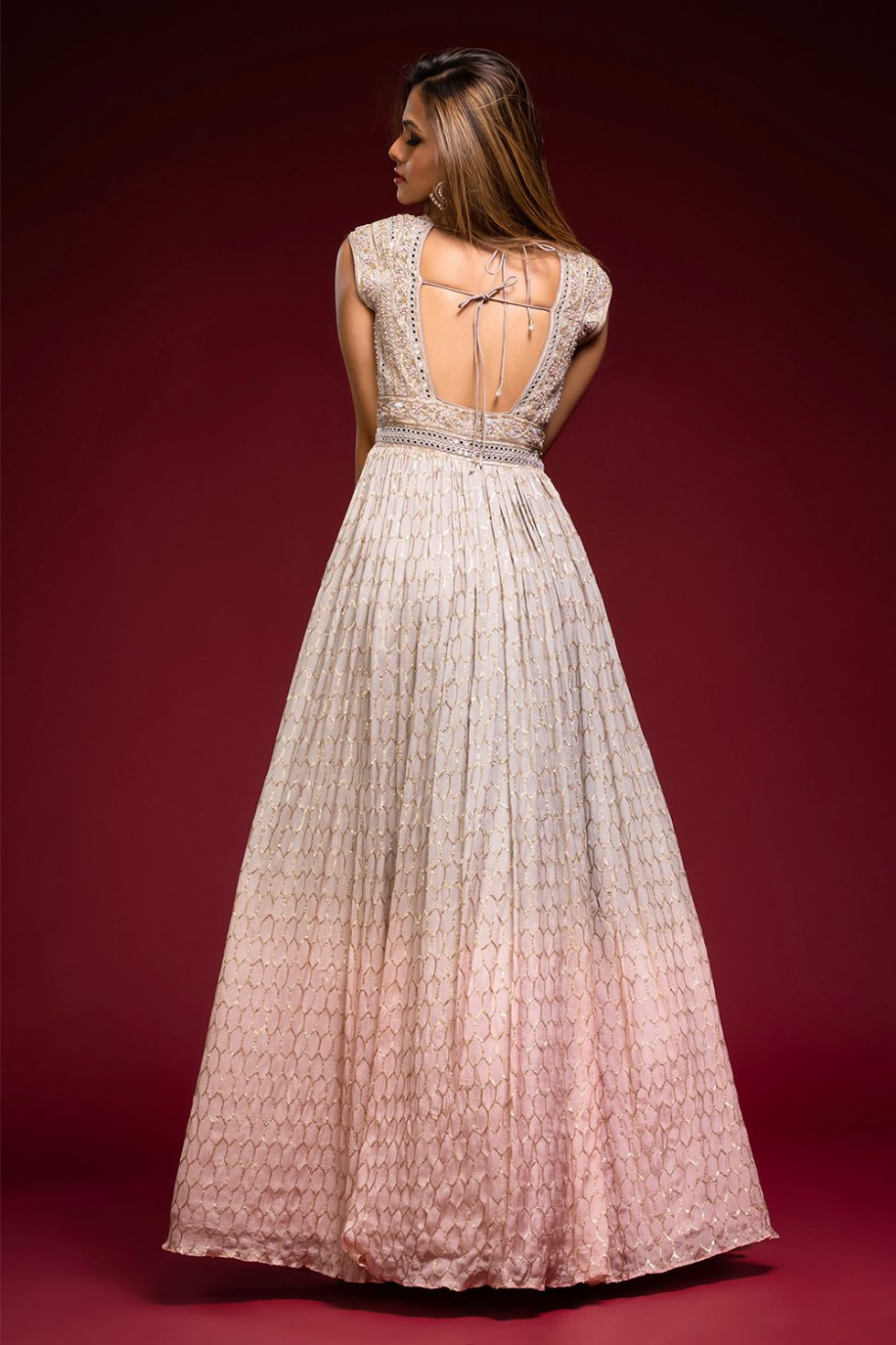 Ombré grey to baby pink gold geometric patterned Anarkali gown set with a hand embroidered bodice paired with a matching shaded dupatta and gold embellishments.