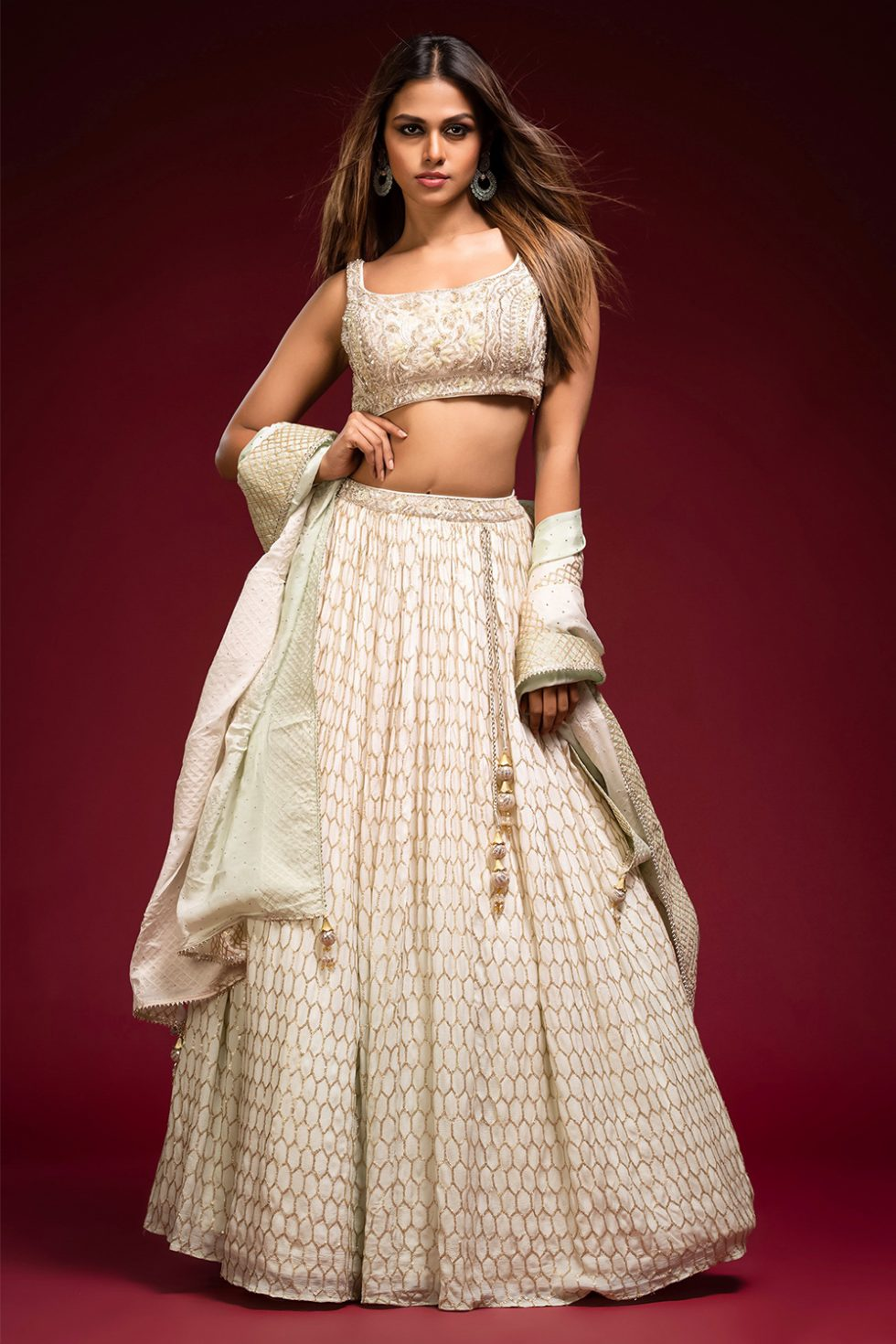 Ombré ivory to mint green geometric gold patterned lehenga set with a hand embroidered blouse paired with a matching gold patterned shaded dupatta.
