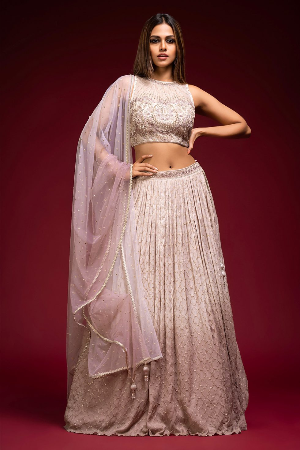 Ombré grey to pink geometric gold patterned lehenga set with a hand embroidered blouse paired with a matching shaded dupatta and gold butis.