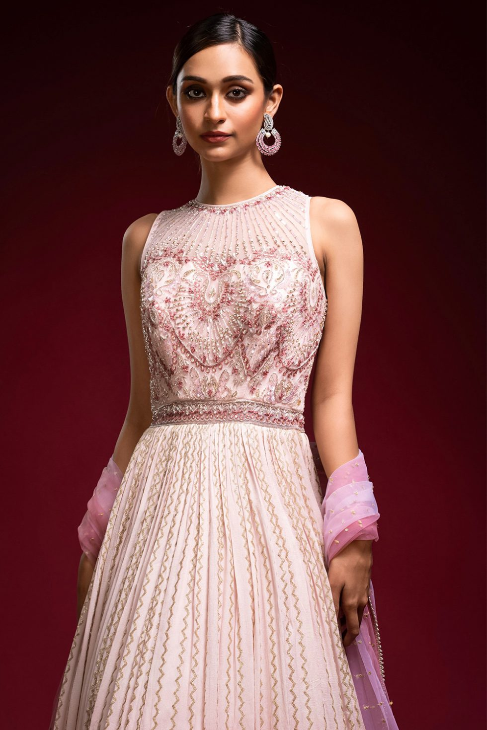 Ombré blush to brick pink gold geometric patterned Anarkali gown set with a hand embroidered bodice paired with a matching shaded dupatta and gold embellishments.