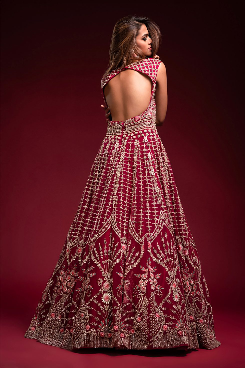 Wine magenta gown set with silver and coloured embroidery and gota work paired with a matching dupatta with silver embellishments.