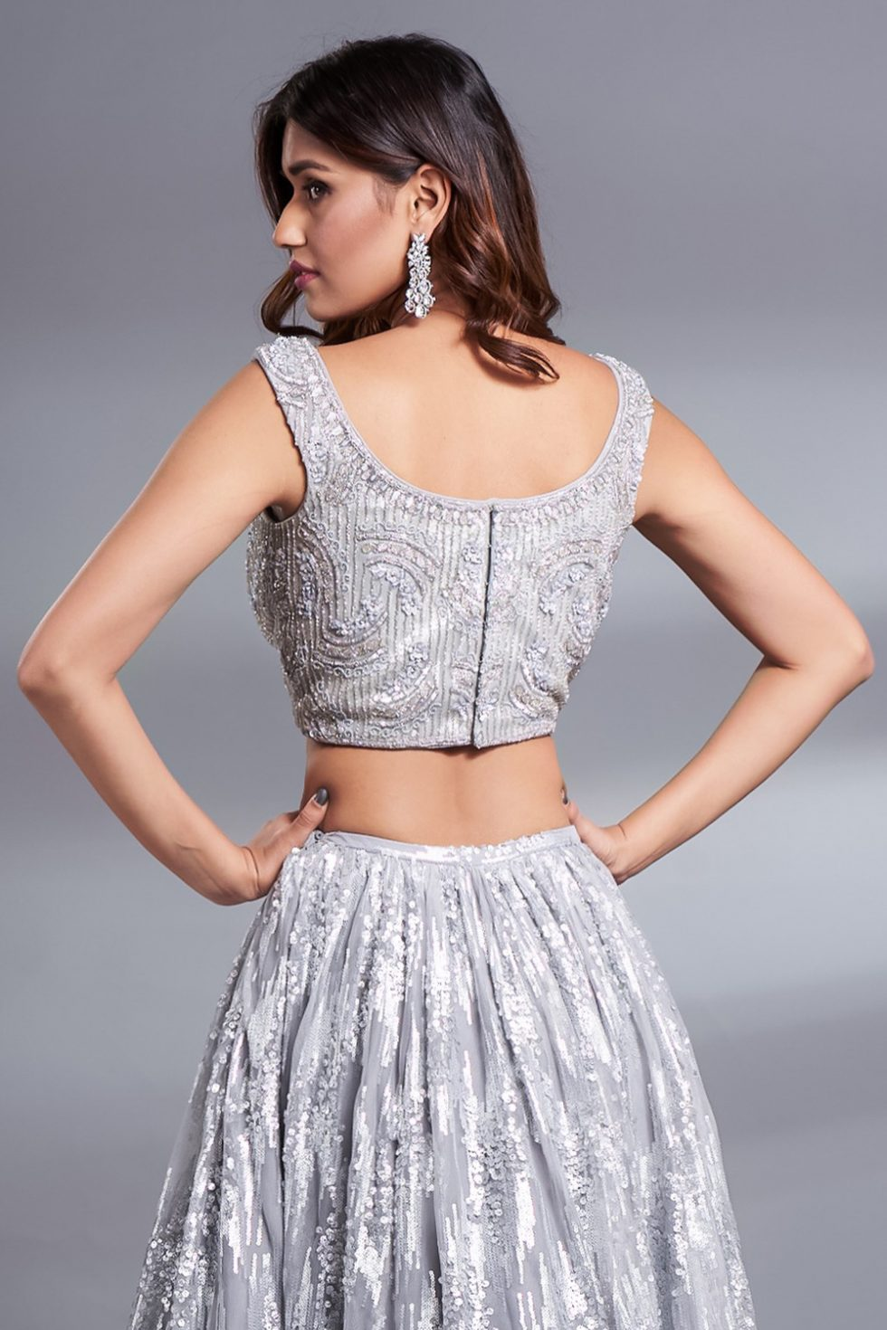 Silver grey hand embroidered blouse with silver embellishments.