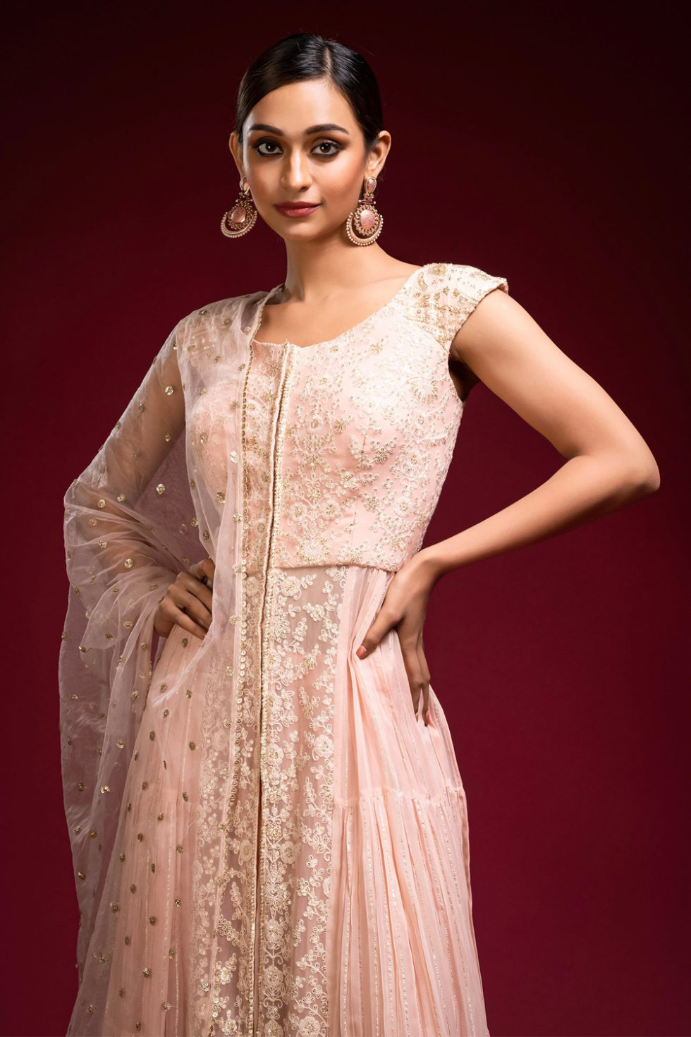 Pinkish peach palazzo pant set with a gold patterned tier panelled chikan long kurta top paired with a matching dupatta and gold butis.