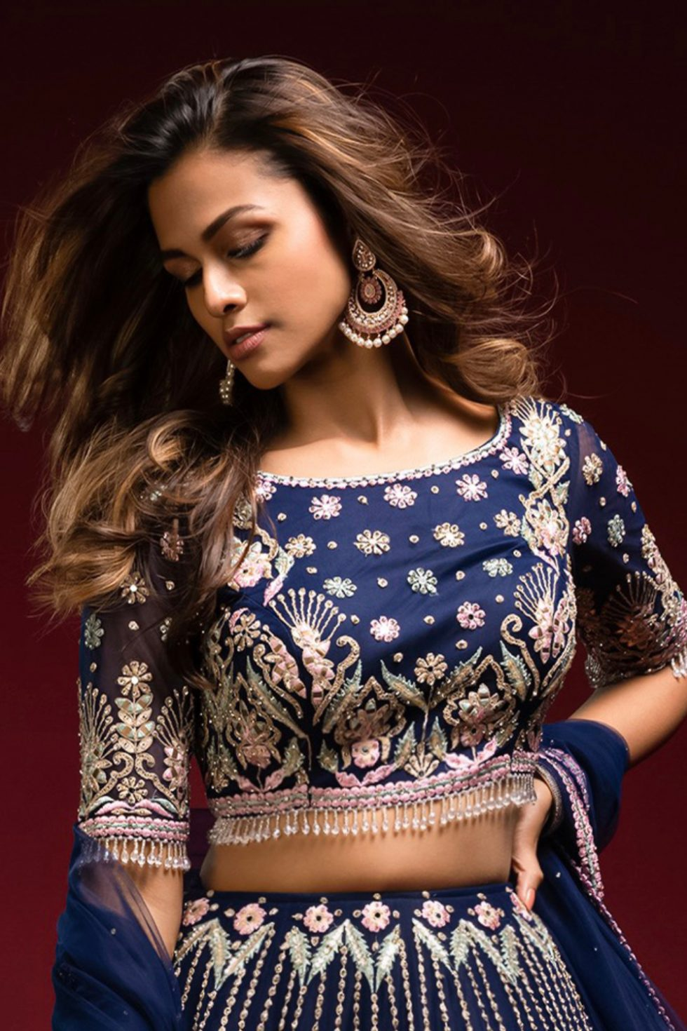 """Navy blue classic blouse with multi coloured embroidery, """"abla"""" and silver embellishments complete with tassels."""