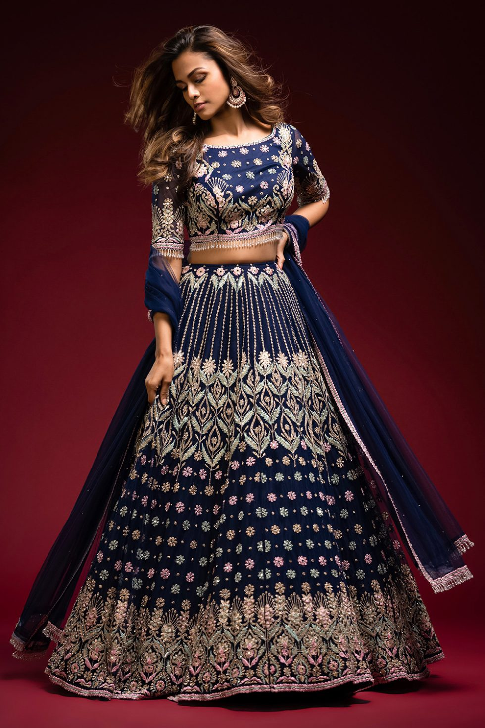 """Navy blue lehenga set with multi coloured embroidery and """"abla"""" paired with a matching dupatta silver embellishments and tassels."""