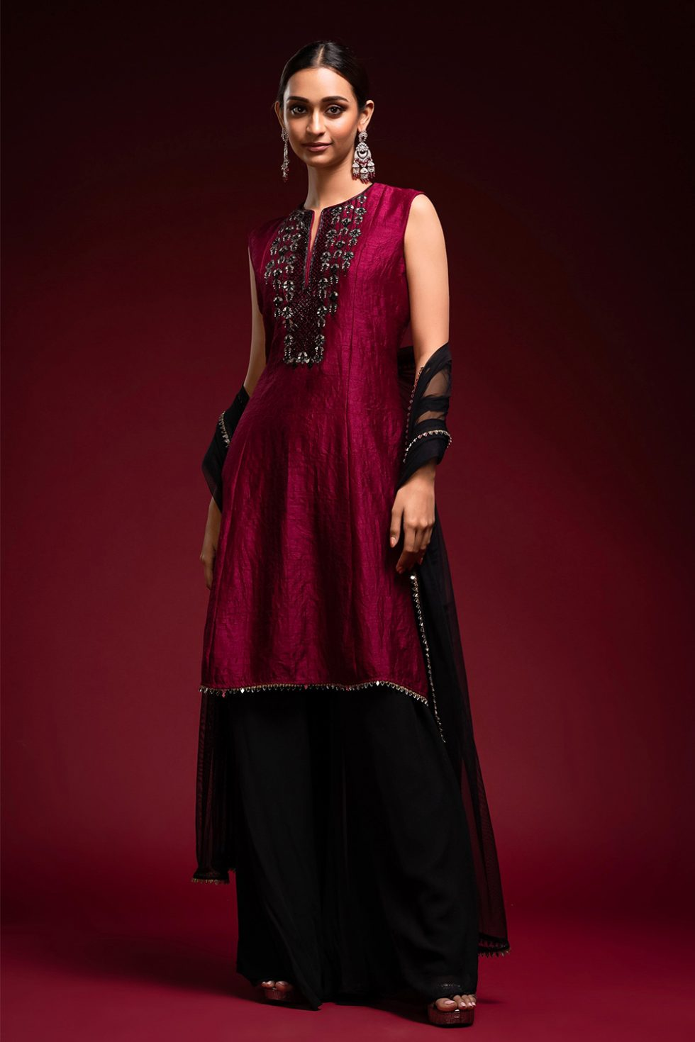 Deep wine red long kurta top with black and gota embroidery neckline with a contrast jet black palazzo pant paired with a matching dupatta.