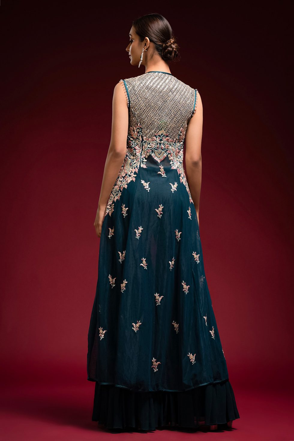TIERED SHARARA PANT SET WITH A LONG JACKET STYLE KURTA TOP WITH MULTI COLOURED EMBROIDERY AND SILVER EMBELLISHMENTS.
