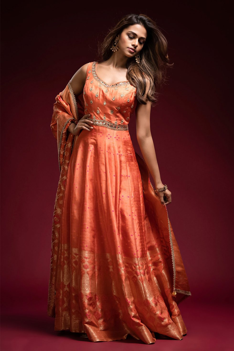 Tangerine orange banarasi anarkali gown set with a gota and gold hand embroidered bodice paired with a matching banarasi dupatta.