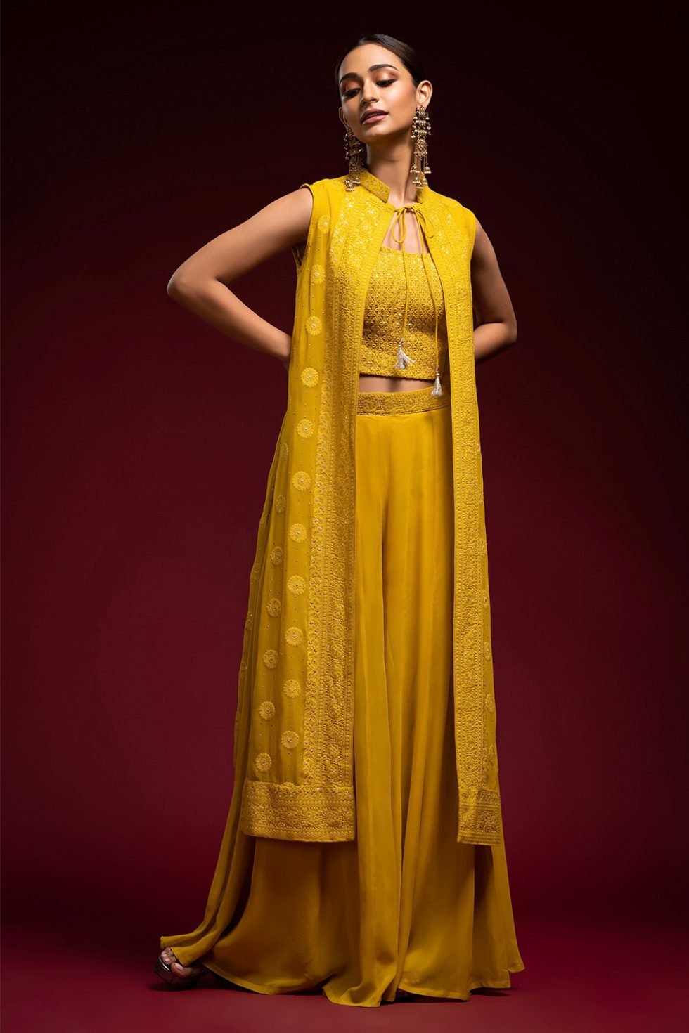 Mustard yellow palazzo pant set with a chikan blouse paired with a matching chikan front tie up jacket.