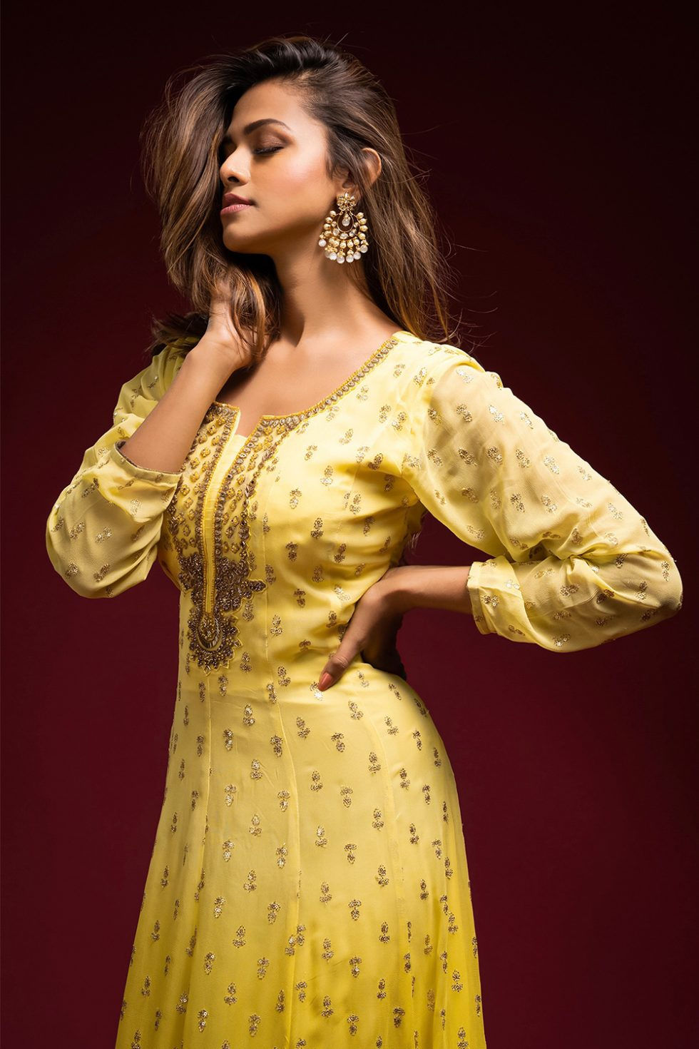 Sunshine yellow ombré Anarkali gown set with an embroidered neckline and butis paired with a matching dupatta and gold highlights.