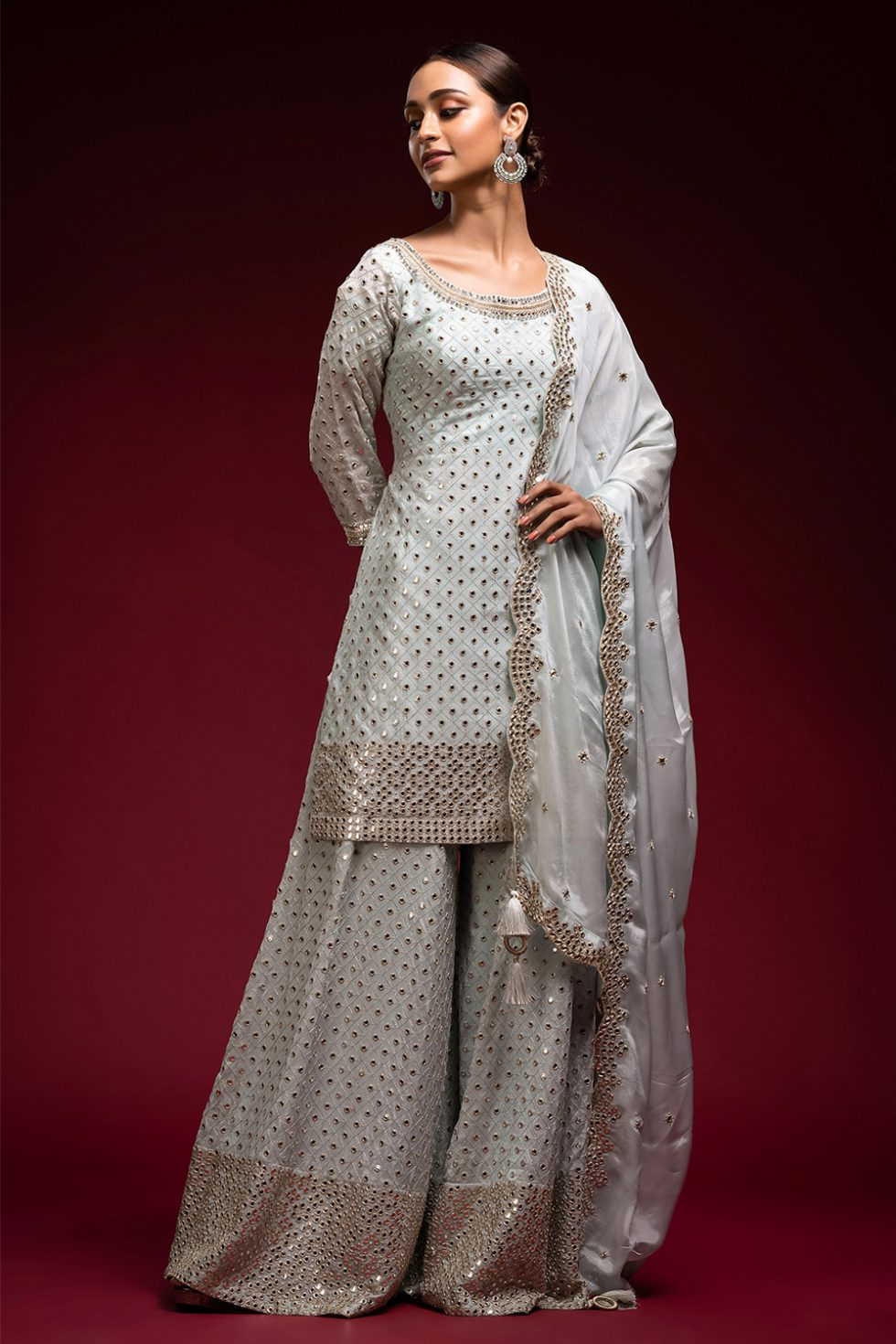 """Powder blue palazzo pant set with """"abla"""" embroidery paired with a matching scalloped dupatta and an embroidered neckline."""