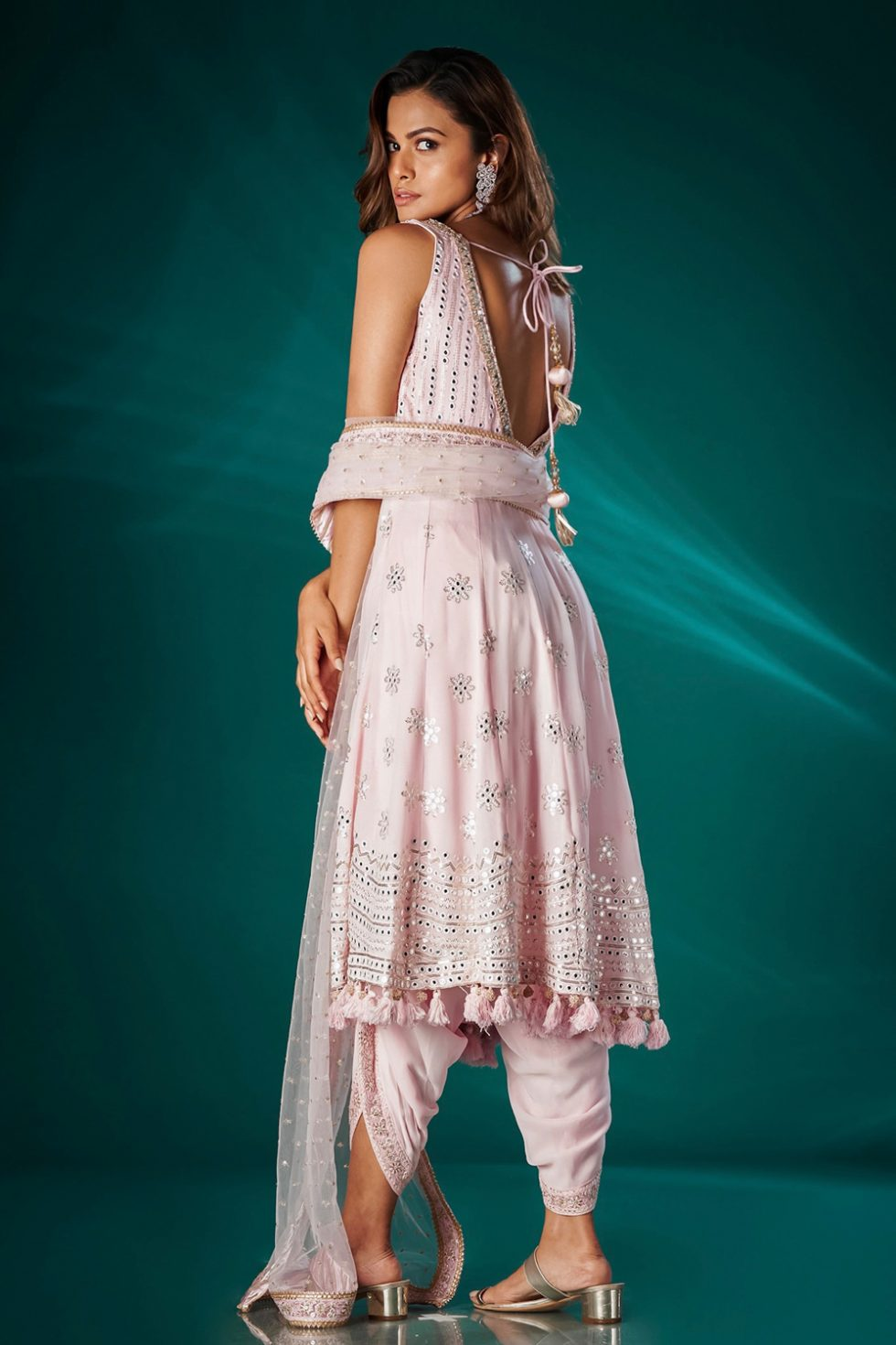 """Sweet pink dhoti pant set with a long """"abla"""" work kurta top paired with a matching dupatta and tassels."""