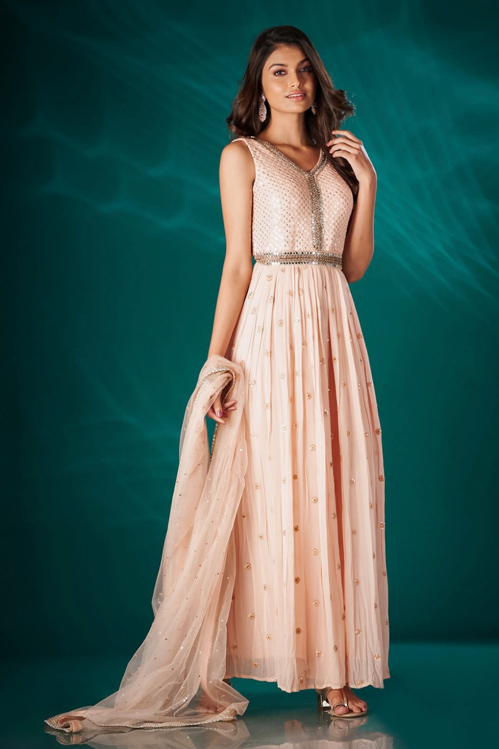 Sweet peach chikan jumpsuit with an embroidered neckline and all over butis paired with a matching dupatta and silver embellishments.