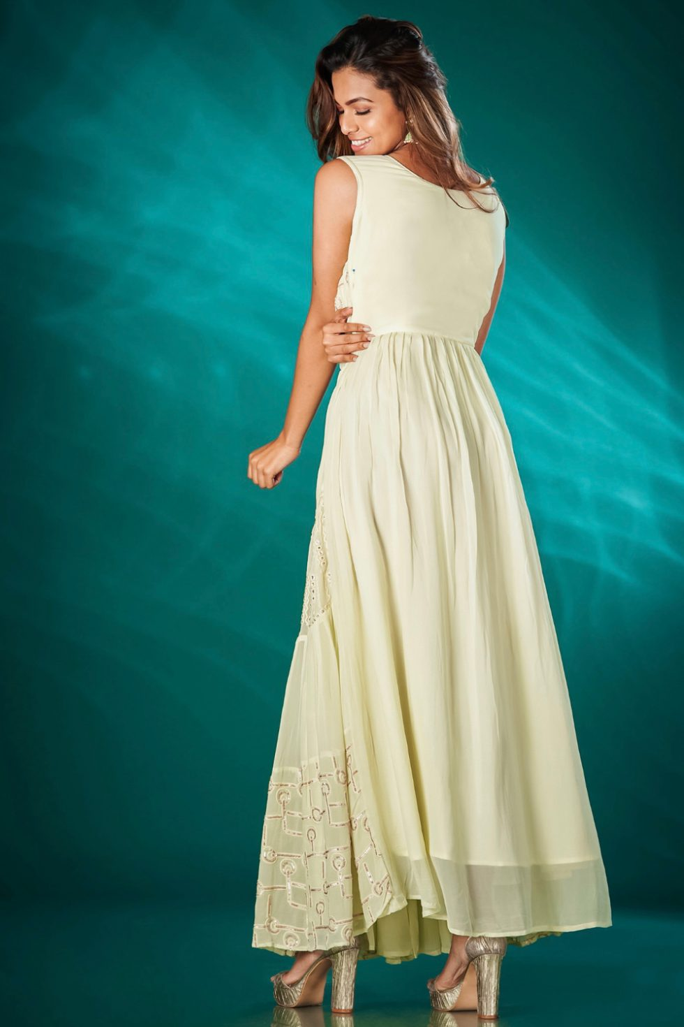 Pastel green long tiered kurti with a mock jacket tie up and embroidered yoke detail.