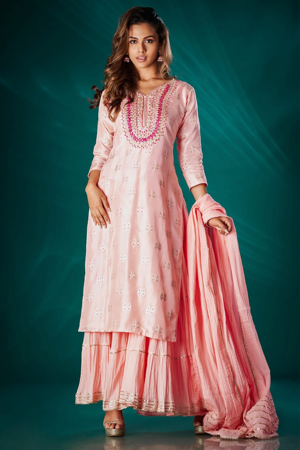 Rose peach tiered one piece kurti with an embroidered neckline paired with a matching dupatta and gold embellishments.