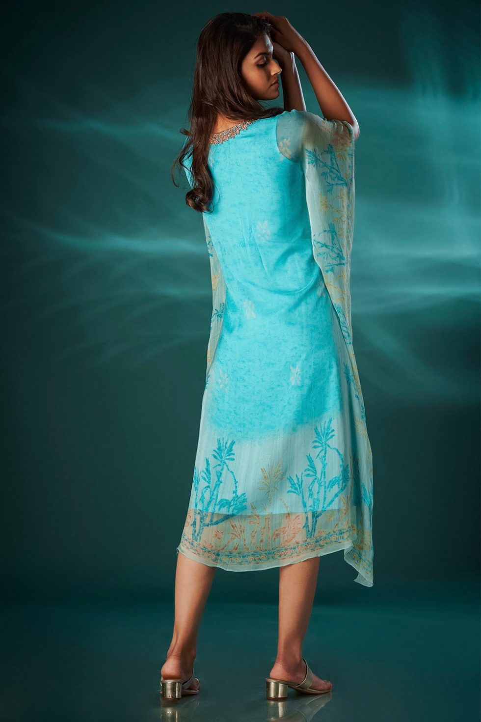 Sky blue kaftan style long printed kurti with an embroidered neckline.