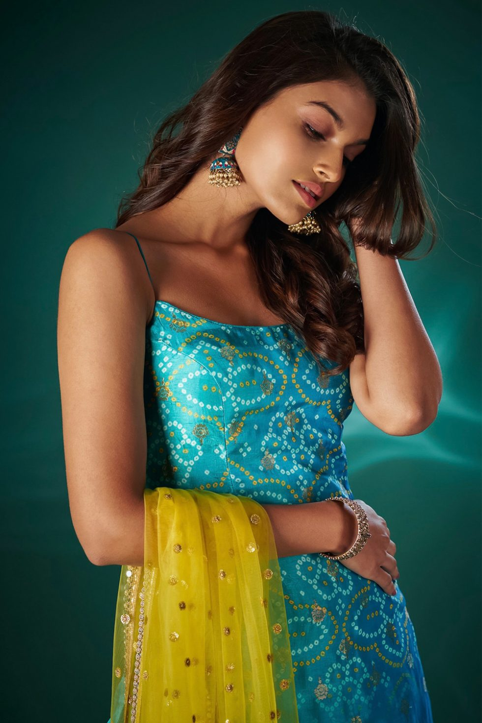 Jewel blue single tiered sharara pant set with a bandhani kurta top paired with a contrast yellow dupatta and gold butis.