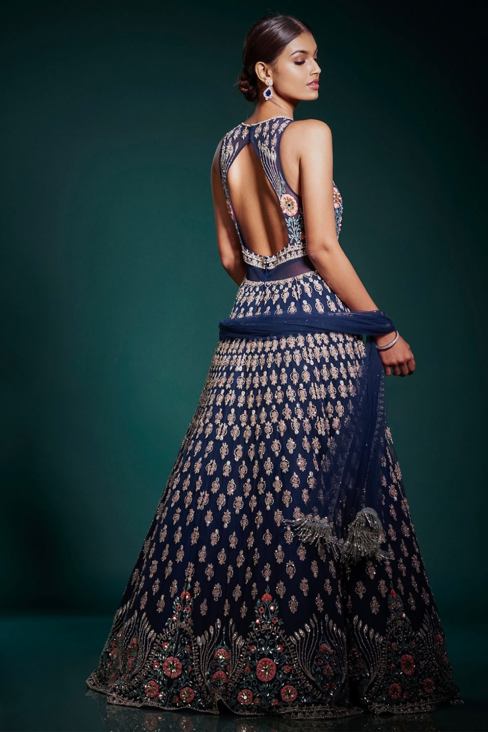 Navy blue gown set with multicoloured embroidery and gota paired with a matching dupatta and silver embellishments.
