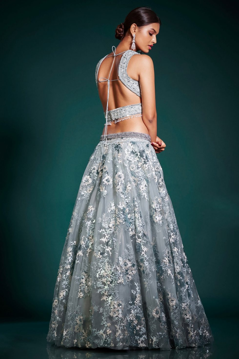 Steel grey lehenga set with a hand embroidered blouse and a lace sequin work skirt paired with a matching dupatta and tassels.