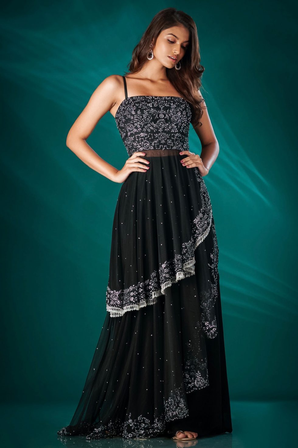 Raven black palazzo pant set with a layered top with silver and black embroidery, embellishments and tassels.