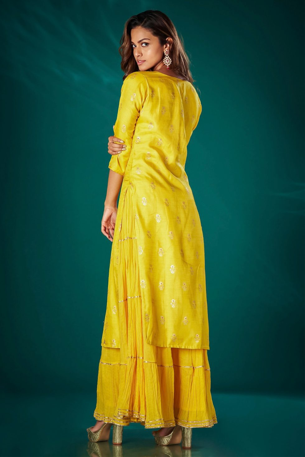 Sunshine yellow self patterned long kurti set with an attached tiered layer paired with a matching dupatta and gota work.