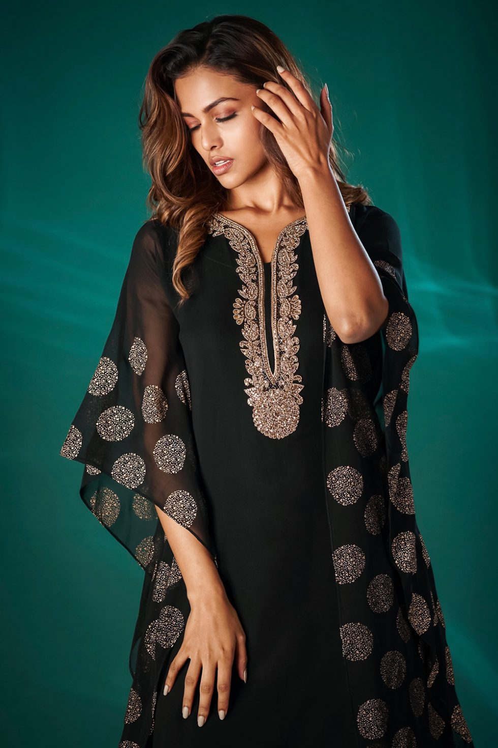 Raven black printed kurti with a handkerchief style hem and embroidered neckline.