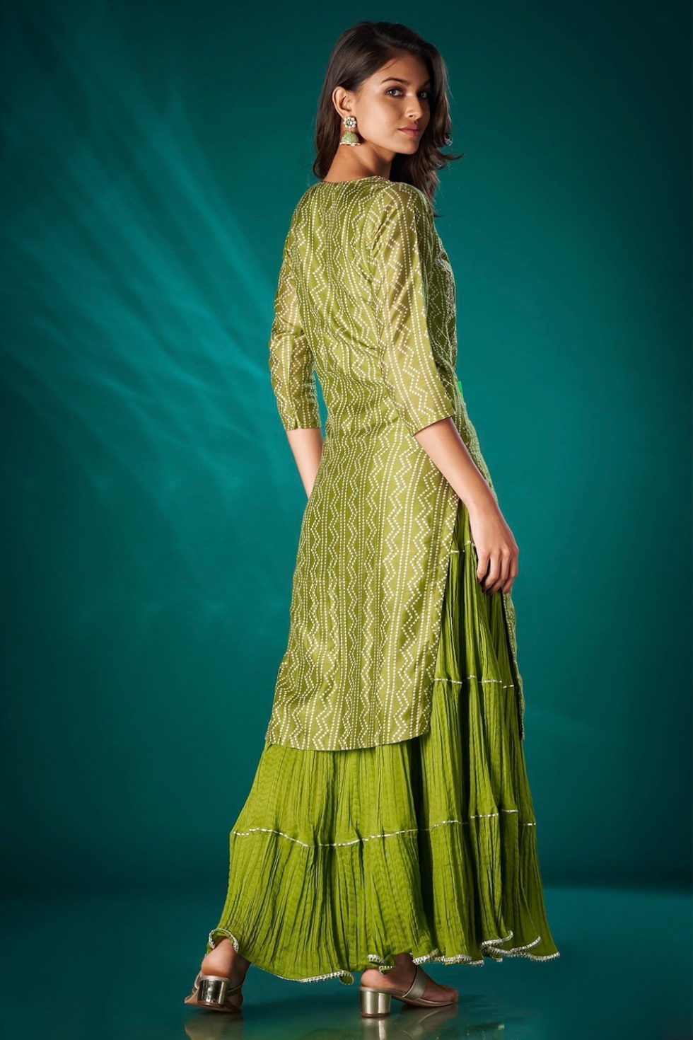 Fern green long printed kurti set with and attached tiered layer and gota work.