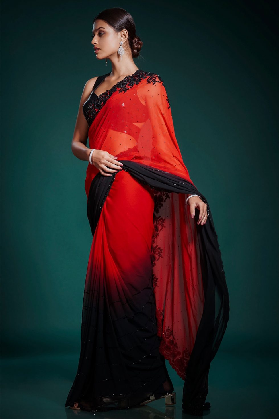 Deep red to black ombré classic saree with contrast black embroidery paired with a black sequin cut out blouse and black highlights.