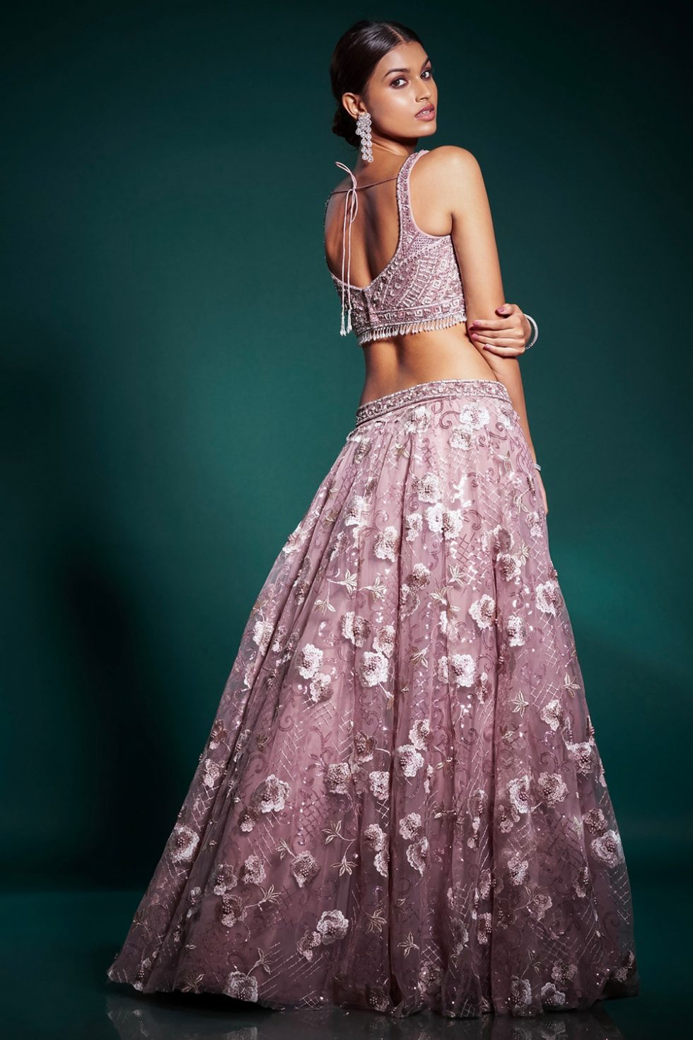 Dusty pink lehenga set with a hand embroidered blouse and a lace sequin work skirt paired with a matching dupatta and tassels.